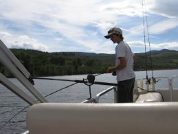 MLC fishing service - Cole catches fish from pontoon boat with guide Dale.