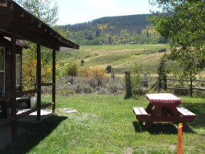 Cabin B picnic table and view of neighbor ranch land